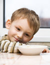 Kid and porridge Royalty Free Stock Photography