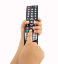 Kid pressing the remote control Royalty Free Stock Photo