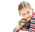 Kid with a puppy on a white background isolated portrait of Stock Images