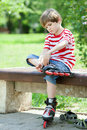 The kid put on roller skates a bench Stock Images