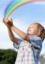 The kid and a rainbow Royalty Free Stock Photo