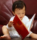 Kid reading a book Royalty Free Stock Image