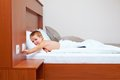 Kid ready to sleep in bedroom turning off the light happy Stock Photo