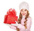 Kid with red Christmas gift box. Royalty Free Stock Images