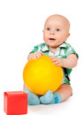 Kid with a red cube and yellow ball Royalty Free Stock Image