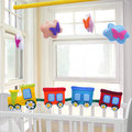 Kid ride baby mobile kids toys in nursery Stock Photo