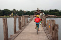 Kid riding bike on U-Bein bridge in Mandalay Royalty Free Stock Image