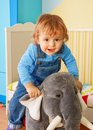 Kid riding a toy elephant Royalty Free Stock Photography
