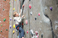 Kid rock climbing Royalty Free Stock Photo
