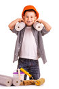 Kid with a roll of wallpaper and brush isolated funny boy Royalty Free Stock Image