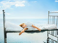 Kid s dreams happy child lying on vintage bed in sea summer romantic concept Royalty Free Stock Photo