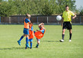 Kid s football a direct free kick on field Stock Photography