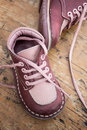 Kid s leather shoes on wooden background Royalty Free Stock Photography