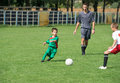Kid s soccer two little boy fight for ball on football match Royalty Free Stock Photos