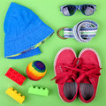 Kid's street outfit and some toys on white background Royalty Free Stock Photo