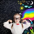 Kid of school age on arts and science background Royalty Free Stock Photo