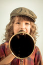 Kid shouting through megaphone vintage communication concept retro style Stock Photos