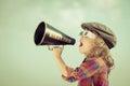 Kid shouting through megaphone Royalty Free Stock Photo