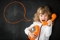 Kid shouting through phone vintage business communication concept Royalty Free Stock Photo