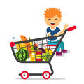 Kid sitting in a supermarket shopping cart Royalty Free Stock Photo