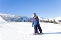 Kid In Ski Mask Skiing On Snow...