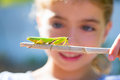 Kid small girl looking praying mantis Royalty Free Stock Photo