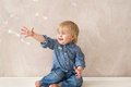 Kid with soap bubbles laughing playing Royalty Free Stock Photo