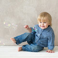 Kid with soap bubbles nice playing in studio Royalty Free Stock Photos