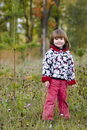 Kid standing in fall forest Stock Photo