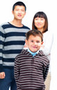 Kid standing in front of his parents on white Royalty Free Stock Photo