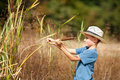 Kid with straw hat playing Royalty Free Stock Photo