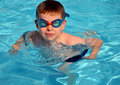 Kid in the swiming pool caucasian boy Stock Photos