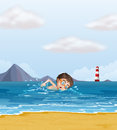 A kid swimming at the beach with a lighthouse illustration of Royalty Free Stock Photos
