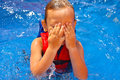 Kid in the swimming pool covered his face with his hands Stock Images