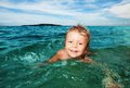 Kid swimming in the sea Stock Images