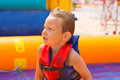 Kid in swimming vest in pool at the water park Royalty Free Stock Image