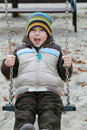 Kid on a swing Royalty Free Stock Photo
