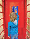 Kid in the telephone box small cute boy british style Stock Images