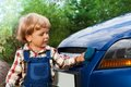 Kid washing car with sponge Stock Image