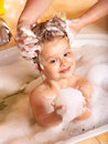 Kid washing hair by shampoo . Stock Photography
