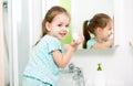 Kid washing hands in bathroom girl Stock Photos