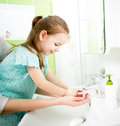 Kid washing hands with mom s help Royalty Free Stock Photography
