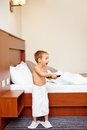 Kid watching tv in hotel room after bathing happy Stock Photos