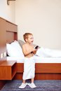 Kid watching tv in hotel room after bathing happy Stock Image