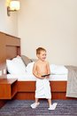 Kid watching tv in hotel room after bathing happy Royalty Free Stock Photos