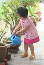 Kid watering plant Royalty Free Stock Photography