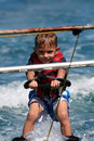 Kid on waterskis Royalty Free Stock Images