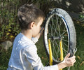 Kid who fix bikes child boy and bicycle Royalty Free Stock Photography