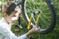 Kid who fix bikes child boy and bicycle Royalty Free Stock Image