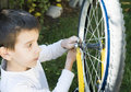 Kid who fix bikes child boy and bicycle Royalty Free Stock Photos